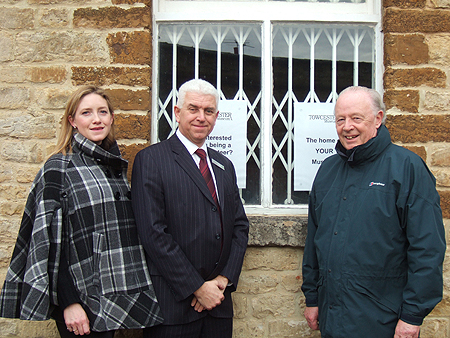 Pictured l-r: Martha Stewart, Treasurer for The Friends of Towcester Museum, Paul Buddin, Departmental Manager for Waitrose, Towcester, and David Nunn, Chairman of the Museum Trust, outside the museum building.