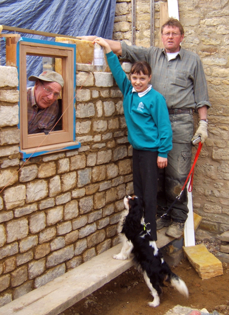 The photo shows Merryn placing the capsule with Malcolm and Alan (builders) and of course Tolly looking on.